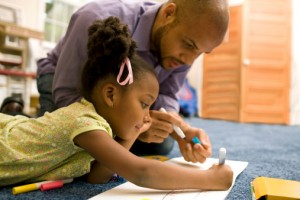 father working on art project with his daughter